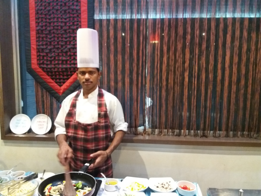 Chef lively preparing pasta
