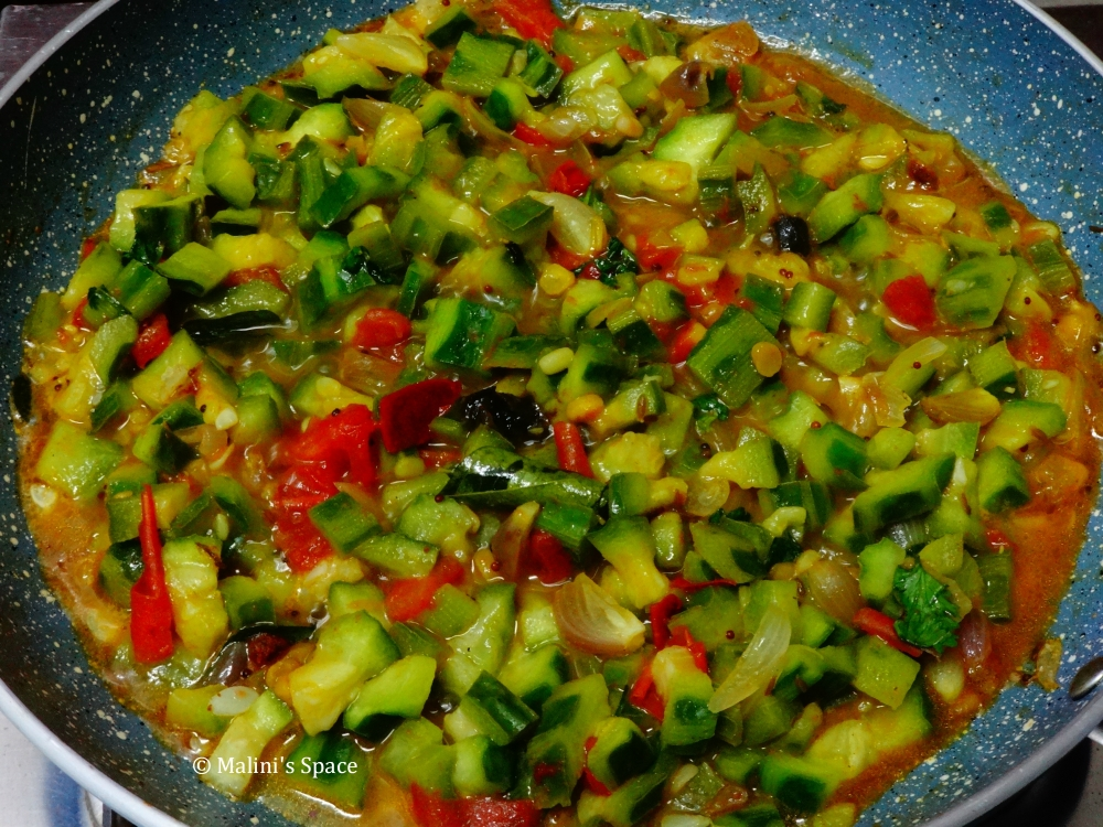 Salt, Tamarind, Turmeric and Chili powder are added.