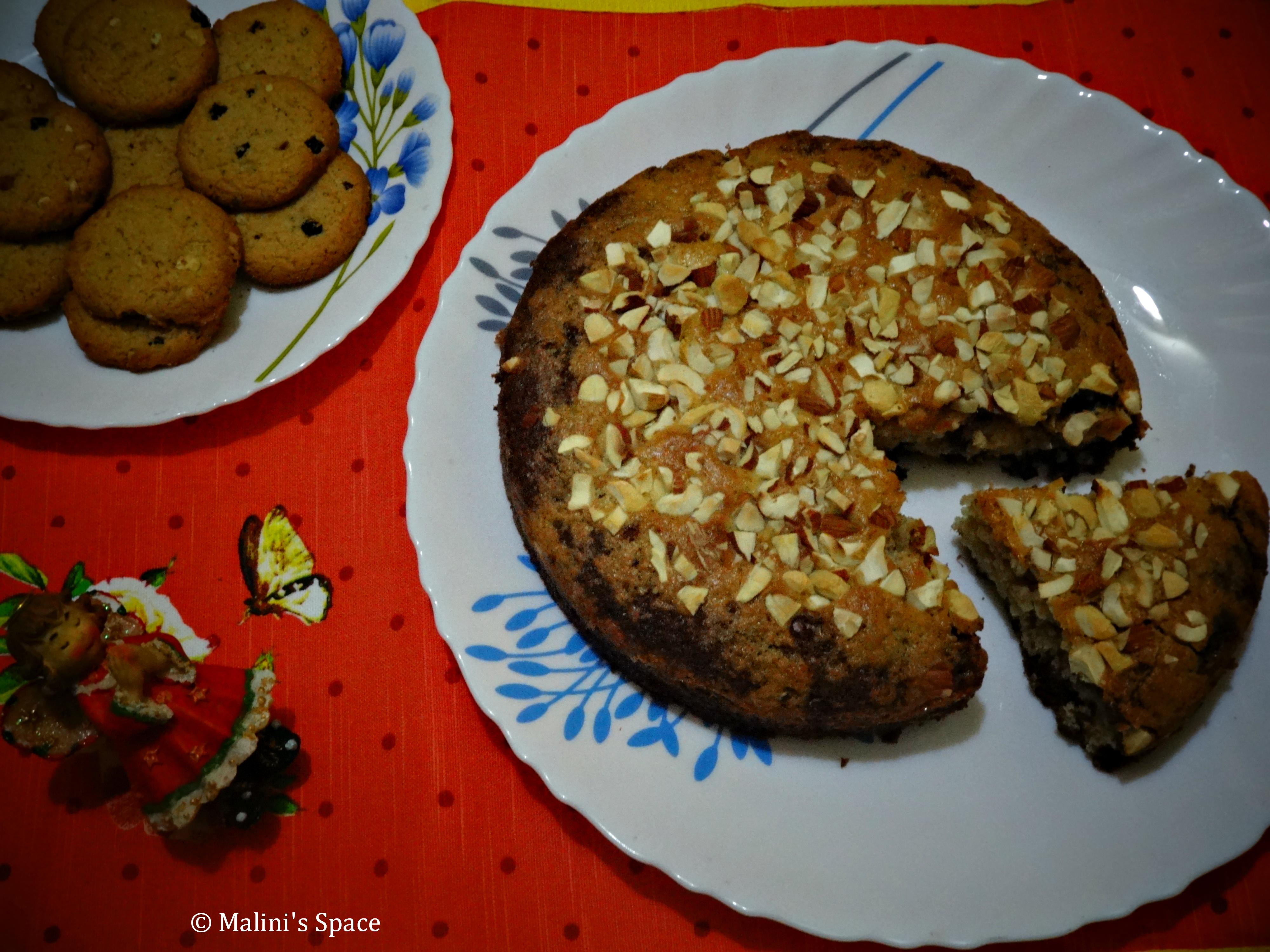 Egg-less Cocoa Bread Cake topped with Nuts